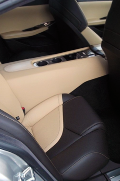 4-seater, With a huge tunnel, like the Porsche Panamera