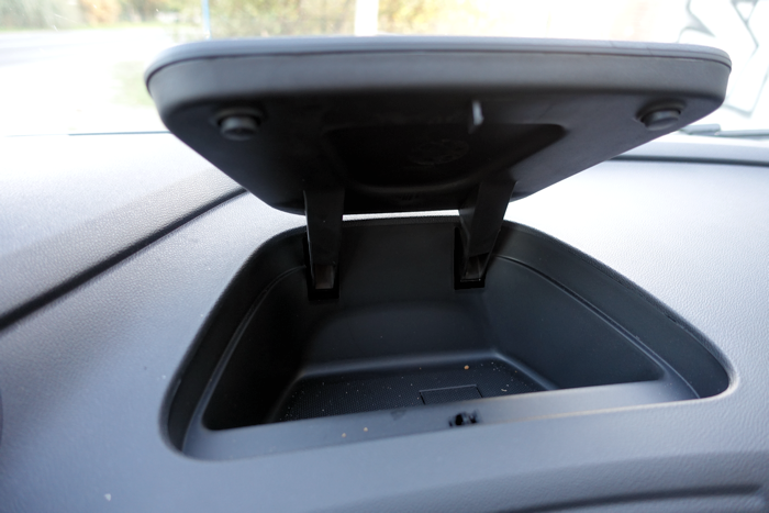 An extra storage bin on top of the dashboard.